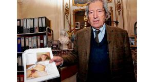 Jean-Jacques Fernier with reproductions of L'Origine du Monde and the newly-found portrait. photographs: getty images, reuters