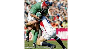 Anthony Foley being tackled by Lawrence Dallaglio during the Grand Slam match of 2003. photographs: inpho