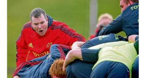 Anthony Foley exhorts the Munster forwards during training. photographs: inpho