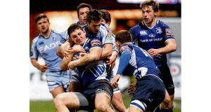Leinster's Darren Hudson is held by Cardiff Blues' Jason Tovey during last night's clash at Cardiff Arms Park. photograph: huw evans/inpho