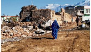 Survivors: a woman walks through the rubble of a suicide bomb in Wardak province. photograph: pam constable/the washington post via getty images