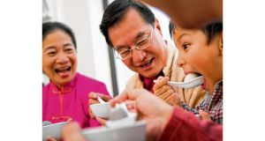 A family enjoys dumplings for new year