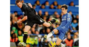 Wigan Athletic's James McCarthy (left) and Chelseas Emboaba Oscar in action at Stamford Bridge on Saturday.