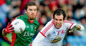 Chris Barrett of Mayo is tackled by Tyrone's Justin McMahon at Castlebar yesterday. photograph: miike shaughnessy/inpho