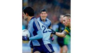 Kerry's Barry John Keane tugs the jersey of Dublin Cian O'Sullivan during yesterday's Allianz National Football League Division One clash in Killarney. Photograph: Ryan Byrne/Inpho