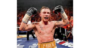 Carl Frampton celebrates victory over Kiko Martinez