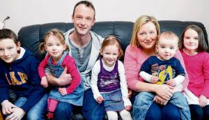 Damien and Karen OConnell, with their children Mark (12), Aimee (3), Emma (4), Dylan (18 months) and Katie (7), at Hollywood, Co Wicklow. photograph: eric luke
