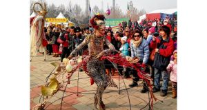 Members of Macnas taking part in Chinese New Year celebrations in Beijing's Chaoyang Park. Thousands of spectators have been drawn to their shows. photograph: clifford coonan