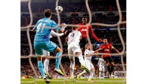Danny Welbeck shrugs off Sergio Ramos' attentions to head home Wayne Rooney's corner. Photograph: Mike Hewitt/Getty Images