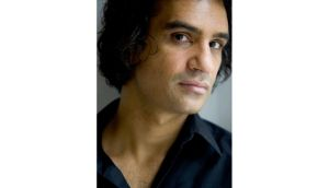 In his latest book, Nadeem Aslam (pictured) features a snow leopard as a 'symbol of a spoiled Eden and the fact that we're not paying attention to these other creatures that we are privileged enough to share the planet with'. Main Photograph: Steve Winter, Getty Images/National Geographic