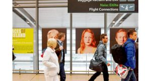Kevin Abosch's Faces of Ireland exhibition line the walls at Dublin Airport. Potograph Curtesy of Kevin Abosch