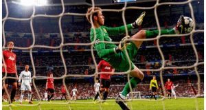 Manchester United goalkeeper David De Gea makes one of his vital saves during their Champions League tie against Real Madrid at the Bernabeu.