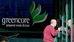 A man enters the Greencore factory building in Bristol. photograph: getty images
