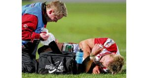 Luke Marshall, one of the contenders to replace Gordon D'Arcy, lies injured on the pitch during Ulster's 26-3 win over Zebre at Ravenhill last night. Photograph: Inpho