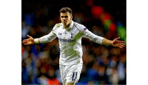 Gareth Bale celebrates after scoring this second goal from a free kick against Olympique Lyonnais at White Hart Lane on Thursday night, the latest glorious strike in a great season. Photograph: Paul Gilham/Getty Images