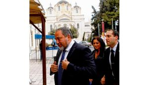 Avigdor Lieberman (left), former Israeli foreign minister, arrives at Jerusalems magistrate court yesterday. photograph: baz ratner/reuters