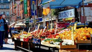 Moore Street, home to fruit and veg stalls, supermarkets and discount stores. Photograph: Brenda Fitzsimons
