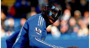 Demba Ba: won a scruffy aerial challenge to help present Juan Mata with the opening goal yesterday