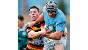 Lansdowne's John Cooney tackles Anthony Kavanagh of Garryowen during their AIL game on Saturday. Photograph: Inpho