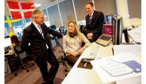 Minister for Jobs Richard Bruton with Christianne Wahl of Facebook and acting head of office for Facebook Ireland Gareth Lambe. photograph: jason clarke