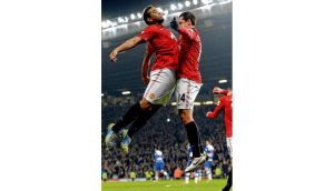 Manchester United striker Javier Hernandez (right) celebrates scoring his side's second goal with team-mate Anderson during last night's FA Cup fifth round tie against Reading at Old Trafford. photograph: paul ellis/afp/getty images