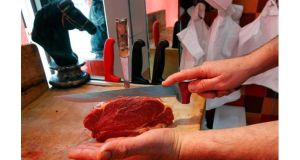A French butcher cuts a piece of horsemeat on a block in a horse butchery shop in Marseille. Photograph: Jean-Paul Pelissier/Reuters