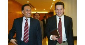 Independent Australian Senator Nick Xenophon (R) and Malaysian opposition leader Anwar Ibrahim share a moment as they walk at the Parliament House in Kuala Lumpur in this 2010 picture. Photograph: Reuters.