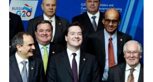 British chancellor George Osborne poses with other finance chiefs for a 'family photograph' at a meeting of the G20 nations in Moscow today. Photograph: Sergei Karpukhin/Reuters.