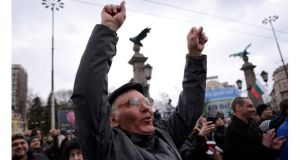 A man shouts slogans as people block the traffic during a protest against high electricity bills in Sofia. Photograph: Tsvetelina Belutova/Reuters.