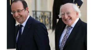 France's president Francois Hollande (left) welcomes President Michael D. Higgins at the Elysee Palace in Paris, today. Photograph: Philippe Wojazer/Reuters