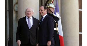 French president Francois Hollande welcomes President Michael D Higgins to the Elysee Palace in Paris today. Photograph: Philippe Wojazer/Reuters