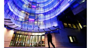 A man enters the BBC New Broadcasting House in London. Photograph: Reuters