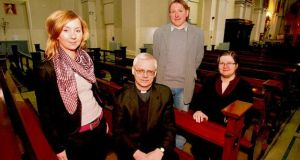 'People in Poland are so stressed and so afraid of losing their jobs. Here it's the opposite, it's so relaxed . . Sometimes too relaxed,' says Kasia Wodniak, above left, with Fr Jaroslaw Maszkiewicz, Tomasz Bastkowski and Aneta Oczki, in the Polish Chaplaincy, St Audoen's Church, Dublin 8.