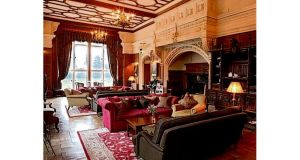 Refuge: the Baronial Hall at Lough Rynn Castle Hotel, and one of its French Stables bedrooms (below)