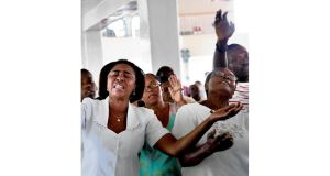 Women pray at Mass in the Alta Grace Church in the Delmas area
