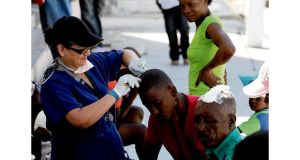 A doctor from the Cuban Medical Centre cares for patients on the street. Photograph: Brenda Fitzsimons