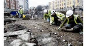 "Archaeologists from Margaret Gowen Co comb through the site at Hammond Lane, off Church Street, just north of the Liffey. It is hoped to establish that a ""Hiberno-Norse suburb"" existed there. Photograph: Dara Mac Dónaill"