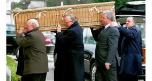 The remains of Padraig MacKernan are carried by family and friends
