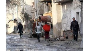 Residents flee from their neighbourhood as Free Syrian Army members walk in near Al Neirab airport in Aleppo. Photograph: Hamid Khatib/Reuters