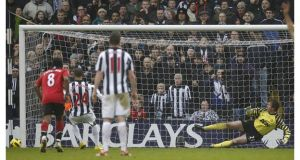 Peter Odemwingie drags his penalty wide against Manchester United at the Hawthorns. - (Photograph: Darren Staples/Reuters)