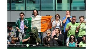 Fans of Conor Niland cheer him from the stands of Court 17 during his first round match at Wimbledon. Photograph: Anthony Devlin/PA