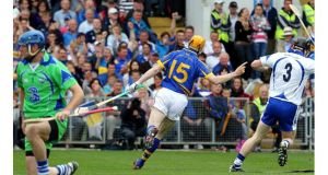 Tipperary's Lar Corbett celebrates after scoring one of his three first half goals against Waterford at Páirc Uí Chaoimh. - (Photograph: Lorraine O'Sullivan/Inpho)