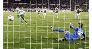 Stephen O'Donnell scores the winning penalty against Partizan Belgrade tonight. Photograph: Ivan Milutinovic/Reuters