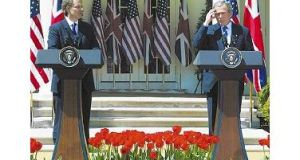 Mr Tony Blair and Mr George Bush during a news conference in the Rose Garden in the White House yesterday.