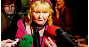 Mary Smyth speaks to media outside the Dáil after the apology from Enda Kenny. photograph: alan betson