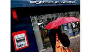 An ATM machine in Frankfurt: bankers' bonuses may be capped at no more than a year's salary. photograph: reuters/lisi niesner