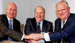 Irish Life's Kevin Murphy, Minister for Finance Michael Noonan and Great-West Lifeco's Allen Loney shake on a €1.3 billion deal yesterday. photograph: mac innes