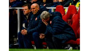 Underfire Arsenal manager Arsene Wenger feels the pressure during last night's 3-1 defeat to Bayern Munich at the Emirates Stadium. photograph: Getty Images