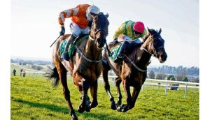 Andrew Lynch on Buckers Bridge (right) pulls clear of Ruby Walsh on Twinlight to win the Flyingbolt Novice Steeplechase at Nava, Co Meat, yesterday. photograph: inpho
