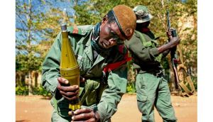 A Malian soldier fixes a rocket during fighting with Islamists in Gao, Mali. photograph: joe penney/reuters